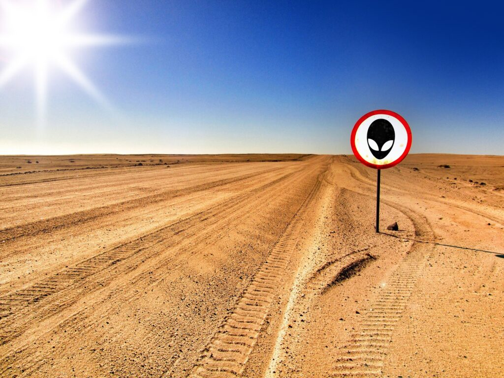 Sand road with sign UFO/Alient is ahead